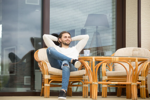 smiling-relaxed-man-enjoying-pleasant-morning-sitting-terrace-outdoor